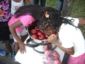 girls bobbing for apples